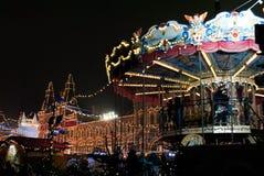 Barnkarusell- och Cristmas ljus Royaltyfria Foton
