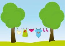 Barnkläder på klädstrecket Royaltyfria Bilder