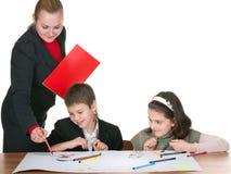 barnklassrum som tecknar två Royaltyfria Bilder
