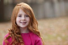 barnkvinnligredhead Arkivfoto