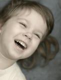 barnlaughter royaltyfria bilder