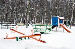 Barnlekplats i horisontalsnö Fotografering för Bildbyråer