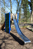 Barnlekplats i parkera Arkivbild