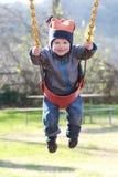 barnlekplatsswing Arkivbild