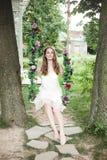 Barnmodell Woman i trädgård Royaltyfri Foto