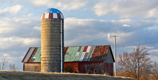 Barnonjay. Rural Wisconsin barn and silo with patch work roof Stock Photos