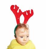 Barnpojke med renhorn på kronhjort Arkivfoto