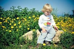 barnrocksitting Arkivfoto