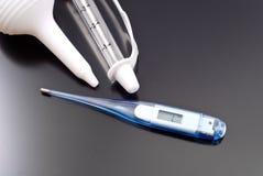 barns elektroniska termometer Arkivbild