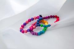 Barns färgade armband Fotografering för Bildbyråer