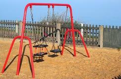Barns gungor i en lekplats Royaltyfria Bilder