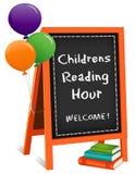 Barns läsande timme, svart tavlastafflitecken, böcker, ballonger Royaltyfria Foton