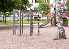 Barns lekplats med glidbanan, klättringramen och att vagga Royaltyfria Foton