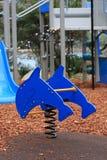 Barns lekplatsutrustning Royaltyfria Foton