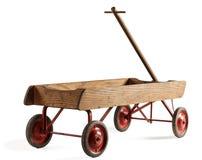 Barns leksakträvagn som isoleras på vit Fotografering för Bildbyråer