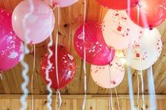 Barns parti med ballonger royaltyfri foto