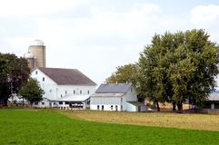 Barns and silos on farm Stock Image