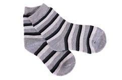 Barns sockor som isoleras på vit bakgrund Arkivfoton