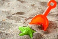 Barns strandleksaker Arkivfoto