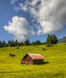 Barns. Wooden barns located on a hill in the middle of the Alps Stock Photography