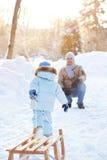 Barnspring med sladgen Fotografering för Bildbyråer