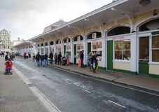 Barnstaple Butchers Row Market. Barnstaple, Devon, UK - October 24, 2009: Butchers row market in Barnstaple selling meat, breads, fruit and vegetables Royalty Free Stock Photography