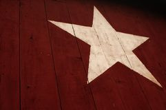 Barnstar. A white star painted on the side of a red barn Royalty Free Stock Images