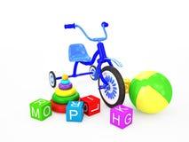 Barntoys med trehjulingen Arkivfoto