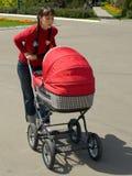 barnvagnkvinna Royaltyfri Foto