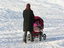 barnvagnmoder Arkivfoto