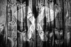 Barnwood axes. Crossed ax emblem on old barn wood panels Royalty Free Stock Photo