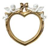 Barocker vergoldeter fhoto Rahmen in der Form des Herzens mit Amoren auf lokalisiertem Hintergrund stockfotografie