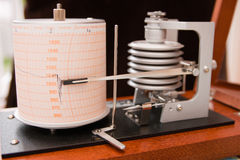 Barograph. In a wooden box with the lid open Stock Image