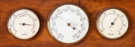 Barometer. Shot of old wooden barometer isolated stock photos