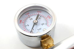 Barometer. High pressure barometer of a pump on white background stock photo