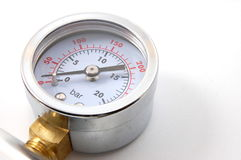 Barometer. High pressure barometer of a pump on white background royalty free stock photography