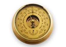 Barometer. In a wooden frame, isolated Stock Photography