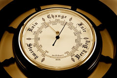 Barometer. The dial of a barometer is photographed close-up Royalty Free Stock Images