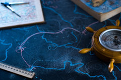 Barometer on a black background with a map. Stock Photo