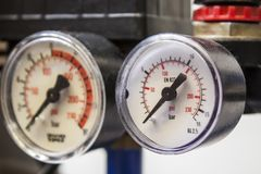 Barometer in blue air compressors Royalty Free Stock Photo
