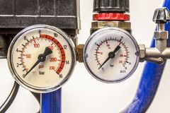 Barometer in blue air compressors Royalty Free Stock Photos