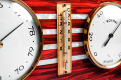 Barometer - detail. Old barometer with thermometer - detail stock photos