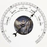 Barometer dial set to fair. A close up of an aneroid barometer with the dial set to fair Stock Image
