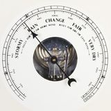 Barometer dial set to rain. A close up of an aneroid barometer with the dial set to rain Stock Photos