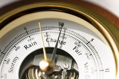 Barometer Change. Close up of aneroid barometer with needle at 30.025 inches stock photo