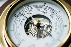 Barometer Stormy. Close up of aneroid barometer with needle at 29.13 inches royalty free stock photos