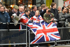 Baroness Thatcher's funeral. London, UK. April 17th, 2013. The crowd waits for Baroness Thatcher funeral procession on Ludgate Hill stock photography