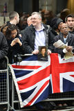 Baroness Thatcher's funeral. London, UK. April 17th, 2013. Man holding a portrait of Baroness Thatcher along the procession route stock image