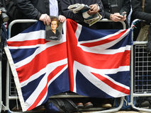 Baroness Thatcher's funeral. London, UK. April 17th, 2013. Man holding a portrait of Baroness Thatcher along the Procession route royalty free stock images