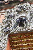 Barong Carving at Pura Petitenget, Bali, Indonesia. Image of an intricate stone carving of the mystical animal known as Barong on a temple door at Pura Royalty Free Stock Photos